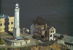 The cellhouse (cream building on right) showing the location of the cellhouse to the lighthouse.