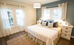HGTV invites you to take a look at this transitional white and blue bedroom with sheer white curtains, a sisal area rug and metal nightstand lamps. Guest Bedroom Decor, Bedding Master Bedroom, Guest Bedrooms, Bedroom Ideas, Blue Bedroom, Master Bedrooms, Masters Of Flip, Interior Paint Colors, Paint Colors For Home