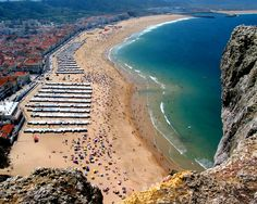 Nazare - Portugal ... eat great seafood here ... also has a furnicular that takes you to the upper town so you get this view of the beach ...