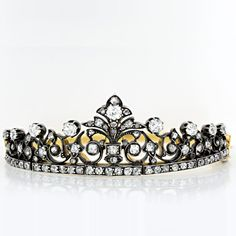 This regal bracelet, created in the form of a tiara, sparkles with 5.00 carats of mine and rose cut diamonds set in silver atop an 18k yellow gold removable hinged bangle taking this very special piece from wrist to hair ornament for maximum versatility. French Hallmarks.