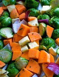 Roasted Sweet Potatoes, Yams, and Brussels Sprouts with Fresh Rosemary Recipe on twopeasandtheirpod.com My favorite fall veggies!