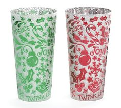 #burtonandburton Handblown frosted white glass candleholder/vase assorted in red and green. Ornaments, holly, snowflakes, peace, joy, twinkle, candycanes, birds and stars design all over with silver interior. #christmas #candle_holder