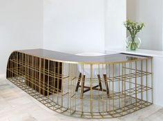 millipede reception desk design: eleftherios ambatzis materials: bronze and palisander veneer wood