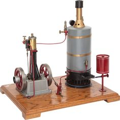 SCHOENNER TYPE LIVE STEAM SCALE MODEL STEAM PLANT 19 x 20 x 14-1/2 inches (48.3 x 50.8 x 36.8 cm) Well engineered vintage model with vertical boiler and engine with two drive wheels.