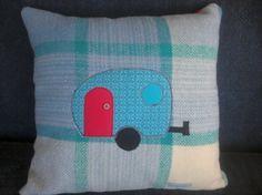 Kiwiana Caravan applique onto upcycled woollen blanket cushion. zip closure. approx. size 40cm x 40cm