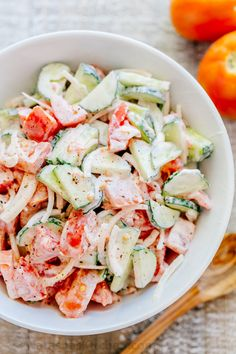 This CLASSIC creamy cucumber and tomato salad is so simple to make and is our go-to summer salad. An easy, excellent cucumber tomato salad. KEEPER!
