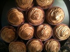 "Entry by Jennifer Ward  ""Chocolate Stout Cupcakes - made with Green's Dubbel Dark Ale and Be Free Bakers Cocoa Bean Cupcake Mix. Easy to make and goes great with a glass of the ""rest"" of the bottle you won't use in the cupcake recipe. :-) Made a dozen because that's how long I have been baking for my sweet gluten free husband - who happens to be a former Guinness fan. This is for you, Scott!"""