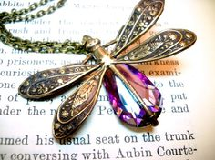Antique brass necklace featuring the mystical dragonfly and a Swarovski rainbow crystal -(I love dragonflies and I think this brass pendant is really beautiful. The Swarovski Rainbow Crystal is a nice addition and a welcoming punch of color.)