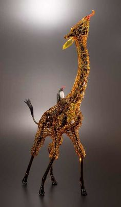 Giraffe with African Tick Bird by Buck and Robert Mickelsen | 15 Pieces Of Glass Art That You Wouldn't Believe Are Pipes