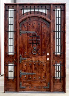 Rustic Exterior Arched Door with Wrought Iron Grills,  Strap Hinges, Clavos Nails and Door Knocker