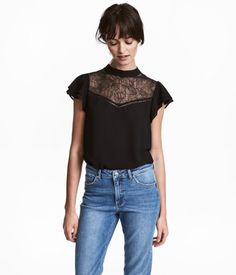 Black. CONSCIOUS. Blouse in woven fabric with a small stand-up collar, opening at back of neck with buttons, and lace yoke at front. Short double-ruffled