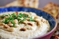 Simple and delicious hummus, made with garbanzo beans, also known as chickpeas, tahini, lemon juice, garlic, olive oil, and salt.
