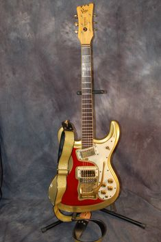 My 1965 Mosrite Original Gold Sparkle with Red Firesripes. I used it on all the electric guitar parts on UrrGod. Lawman-Mike