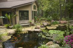 Room with large windows has a great view of the backyard fish pond.