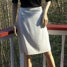 VINTAGE VALENTINO Ivory Skirt W/Retro Back Seams This opulent skirt is a reflection of refined yet unique taste as well as a sincere appreciation for retro fashion. A classic design meets w/vintage-style accents to modestly accentuate the feminine form. This is a rare discovery w/out wasting hrs sorting through your local, thrift store! * 100% fleece wool; * Fully lined; * Ivory; * A solid presentation in front is subtly contrasted by 7, vertical seams @ the rear, which tend to curve w/the…