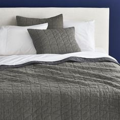 stitch up your sleep.  Comfort is king with soft, 100% cotton hand-quilted coverlets and shams.  Square and triangular stitching adds diagonal dimension.  Mill-dyed in a tonal chambray grey/taupe that flips to solid grey. Hand-quiltedMill-dyed100% cottonTop is quilted taupe; reverses to grey100% polyester fillingMachine washShown with organic white percale sheet set (see additional photos)Made in India.