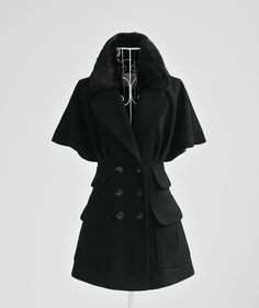 Love the short sleeve wool coat - especially for Texas weather.