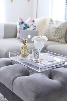 Lucite tray atop an ottoman(Coffee Table Top) Coffee Table Styling, Coffee Table Tray, Cool Coffee Tables, Coffee Table Design, Decorating Coffee Tables, Clear Coffee Table, Leather Ottoman Coffee Table, Footstool Coffee Table, Lucite Tray