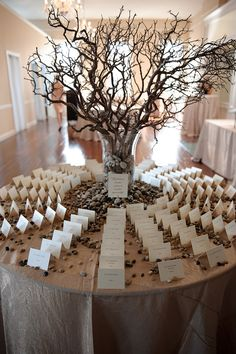Manzanita and river rocks table cards.... Just to show you an idea of the river rocks on the table .... Welcome table....