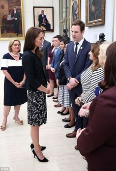 Embassy staff who met the royals were wearingcustom-made badges with a combination of the...