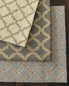 Tin Tile Hooked Wool Rug.  The middle one is a great bridge for a color scheme that will contain grey and beige together.  Great room interior design by www.down2earthdesign.com