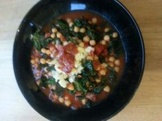 Chorizo, chickpea and kale soup, topped with smoked cheese and crispy fried chorizo