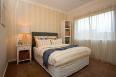 A great mixture of stripe patterns in this bedroom!