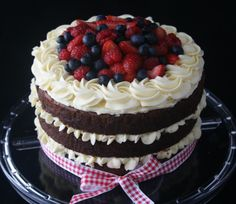 Rustic Red Velvet - Red velvet cake with cream cheese frosting topped with fresh berries