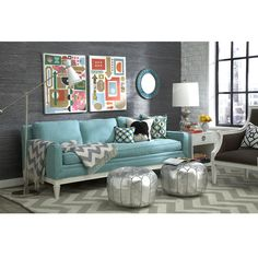 Strong patterns in neutral, dark neutral wall with pops of color. - Adler