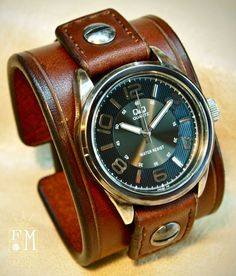 This watch is made using top quality American bridle leather It is 2 wide and scribed around the edges. The watchtabs are handstitched in brown and closes with a hand aged roller buckle. A classic Q&Q hand aged watchface with a black face and water resistant movement sits atop!