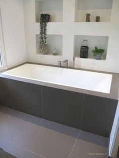 I like the framing of this bath. What about niche boxes on this wall? and then towel rails at the foot of bath?