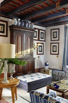 """Cabinet from Northern Spain; Collection of chinese ceramics; Table by Jean Michel Frank; Velvet and floral print """"meridiene"""" used as a coffee table; Roman prints from 16th-century with mahogany frames.   - Veranda.com"""