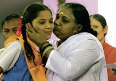 "Devotees of a woman known as Amma, ""The Hugging Saint,"" want to build a 16,000-square-foot building near Santa Fe to accommodate an annual event that draws thousands of people each summer to receive her hugs."