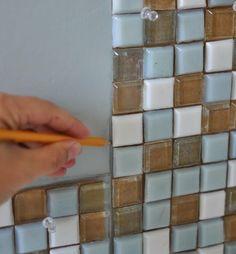 DIY Ways To Amp Up BuilderGrade Basics Builder Grade - Mosaic tile around bathroom mirror for bathroom decor ideas