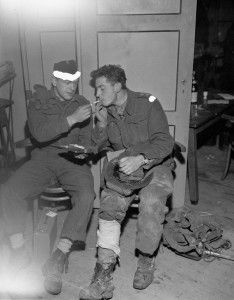 Private D. Tillick of the Toronto Scottish Regiment (M.G.) and Lieutenant T.L. Hoy of the Calgary Highlanders, who both were wounded on the causeway between Beveland and Walcheren, waiting for treatment at the Casualty Clearing Post of the 18th Field Ambulance, Royal Canadian Army Medical Corps (R.C.A.M.C.), Netherlands, 1 November 1944.