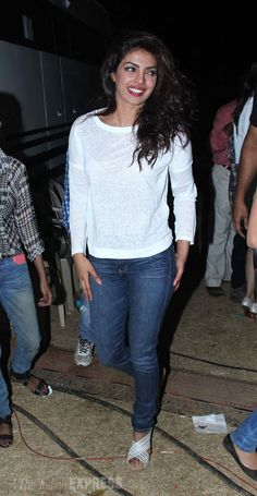 Priyanka Chopra enters the venue in white and with minimal make up.