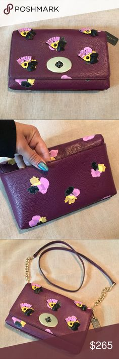 """Rare Coach Lieya Flower Cross Body Clutch Very rare limited edition coach Lieya F37163 Floral AP Crosstown XB MSRP $325 strap is removable. Can be a clutch shoulder bag or crossbody. Polished gold tone. Strap drop is 22"""" Turnlock closure. Brand new. No dustbag. Coach Bags Crossbody Bags"""