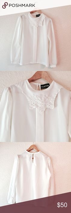 Vintage white blouse with antique collar large Gorgeous vintage white blouse. The collar on this is incredible and is an antique style. Float & feminine and great for all occasions. Claudia brand, made in the USA.  Button closure on he Back of the neck. Marked as a size 14, but runs small due to vintage sizing, so I've listed it as a Large. In excellent condition. Vintage Tops Blouses