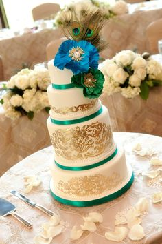 Gorgeous wedding cake with peacock feather accents and gold details