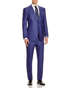 Canali's dedication to classic tailoring and heritage charm imbue this suit with an eye-catching style. Featuring a tonal stripe, this striking Firenze suit can only be found at Bloomingdale's as part of our 100% Collection. #100PercentBloomies