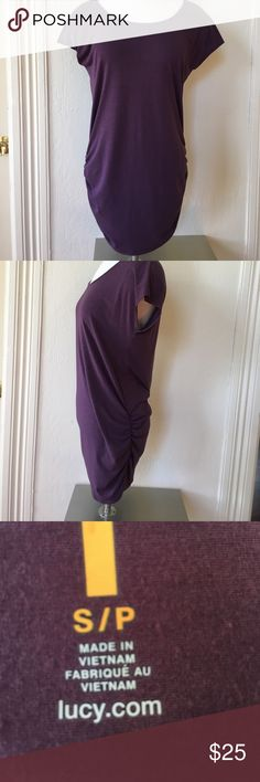 Lucy Short Sleeve Purple Tunic Top A great piece to layer on top of leggings or throw on after yoga to go on your errands. Cotton blend (a bit of Lycra- the material content tag is no longer legible), beautiful plum color, cute gathering at sides. Very flattering cut. Nearly new condition! Roomy small could fit small medium-medium. Lucy Tops Tunics
