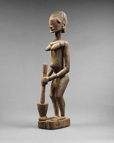 Dogon female figure with mortar and pestle, Mali, 16th-20th century (wood)