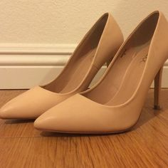 Nude stilettos, worn only once. Size runs a little large. Shoes