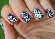 Black & white geometric nails with pops of color by Dressed Up Nails