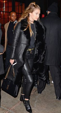 Gigi Hadid in a black shearling Kenneth Cole coat, leather pants, a YSL bag and black booties - click ahead for more winter outfit ideas