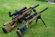 Suppressed Vepr and 10/22.  black on wood. (Source)
