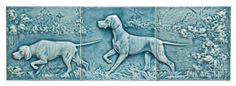 Tripart Pottery Tile Hunting Dog Scene Glazed ceramic Possibly American Encaustic Tile Co. Late 19th/early 20th century Three tiles form two dogs catching scent and pointing in a glossy blue glaze landscape, minor edge nicks, each 6 x 6 in.