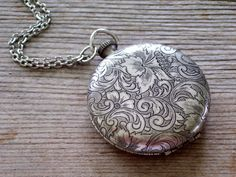 Hey, I found this really awesome Etsy listing at https://www.etsy.com/listing/195818124/antiqued-silver-locket-vintage-floral