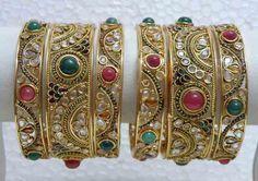 http://allphotosfree.com/wp-content/uploads/2013/01/Polki-Bangles_gold.jpg