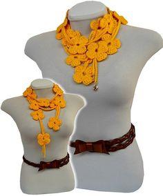 cachecolar feito em croche de lã na cor amarela, com aproximadamente 1,50mts de comprimento, 16 flores, podendo ser usado de várias formas, inclusive como cinto, com muito charme!!! Invente, faça diferente! R$32,00